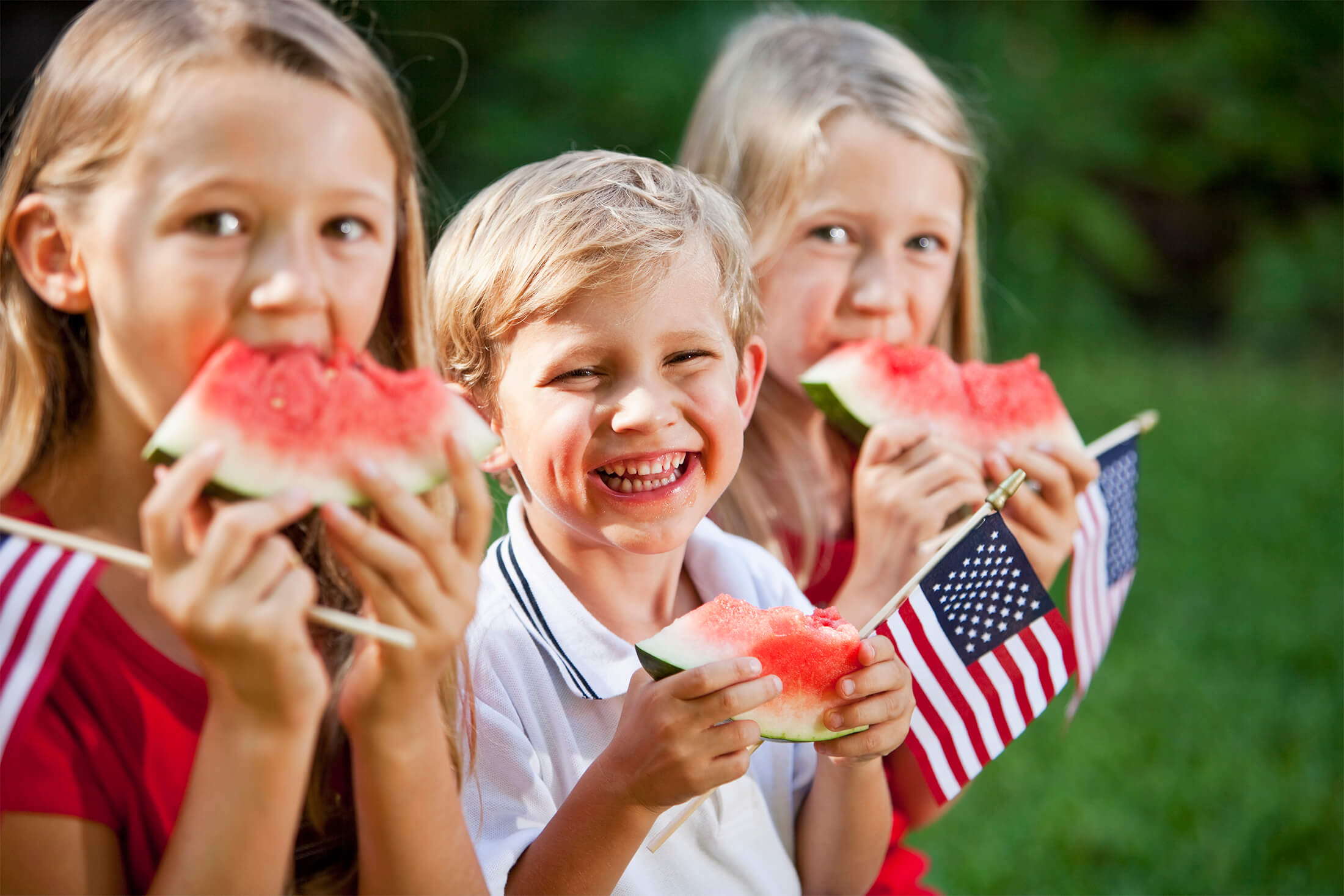 Kids with watermelon at Fourth July in Madden's - Minnesota weekend getaways