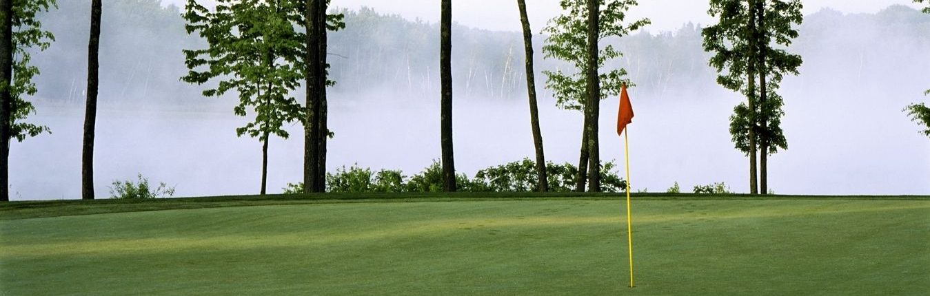golf green on a foggy morning