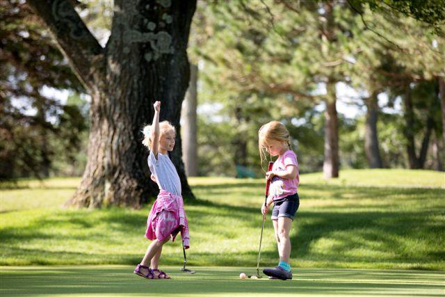 Little girls playing golf