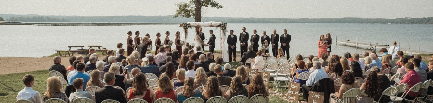 Outdoor lakeside wedding ceremony