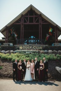 Wedding party in front of the Golf Club at Madden's on Gull Lake