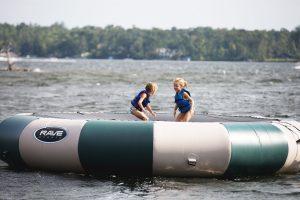 Little girls playing inside a water raft