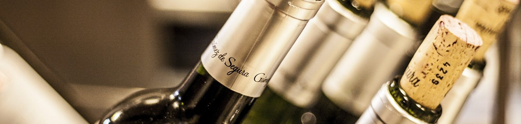 Several bottles of Gomez de Segura wine ready to drink