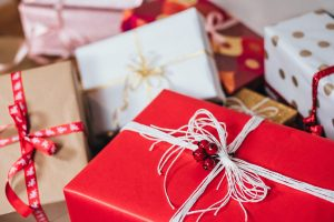 Beautifully wrapped white and red gift boxes with delicate string bows and adornments