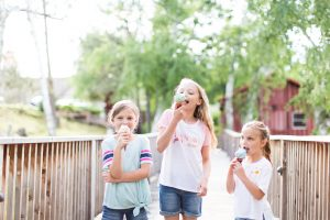 Three little girls eating ice cream