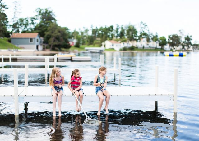 Three little girls fish off the dock of Madden's marina on Gull Lake