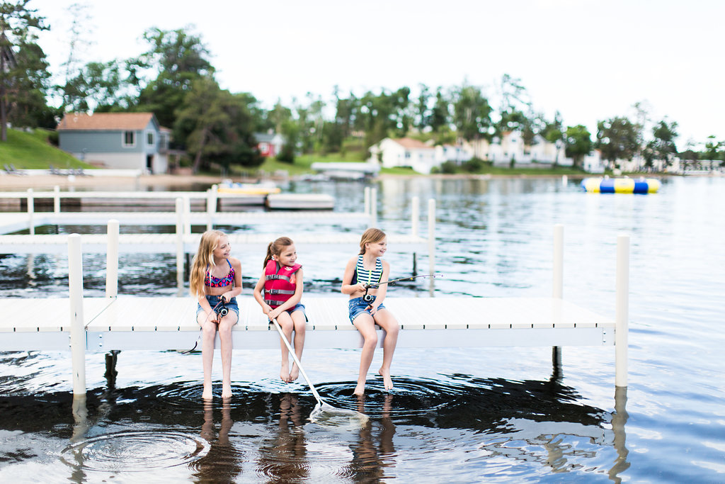 Three little girls fish off the dock of Madden's marina on Gull Lake