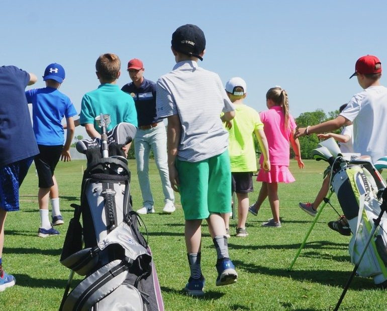 Junior golfers at golf camp at Madden's on Gull Lake