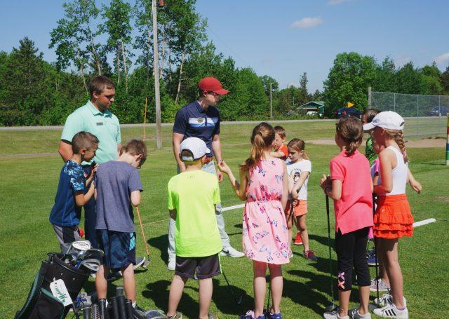 Junior golfers at golf camp at Madden's on Gull Lake