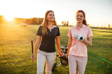 Women Socializing and Golfing