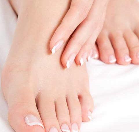 French manicure and pedicure on hands and feet