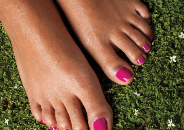 Magenta nail polish on feet