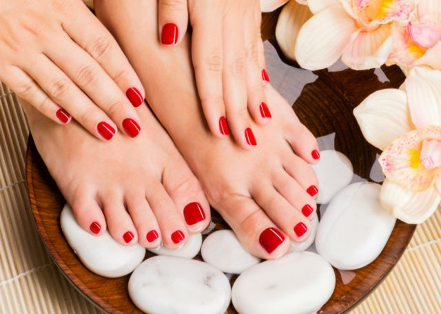 Red nail polish on hands and feet