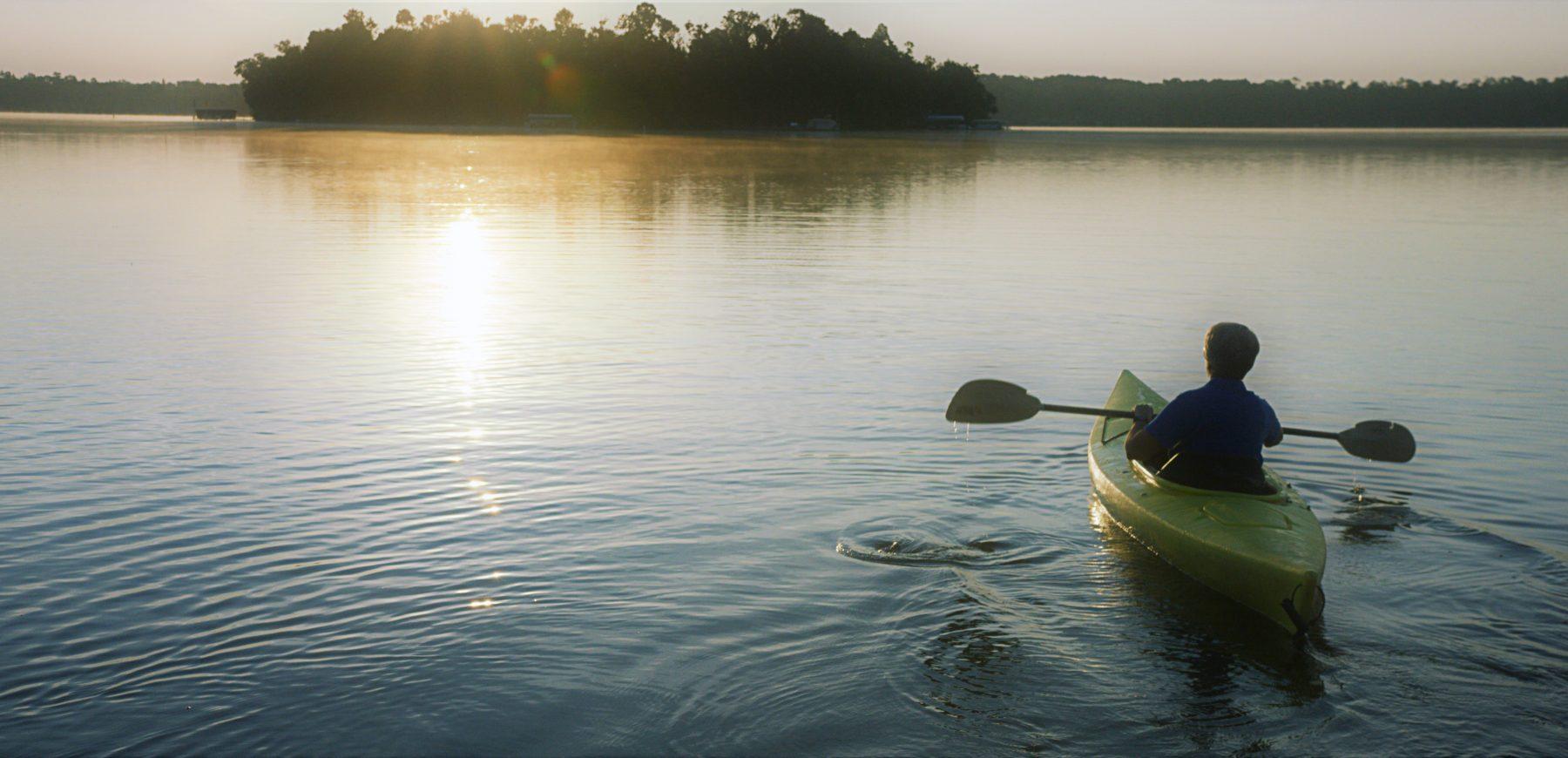 kayak into sunset
