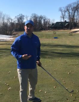 A man with a golf club