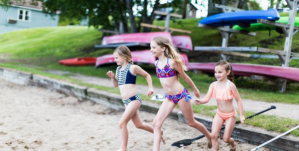 Three girls walking on the beach