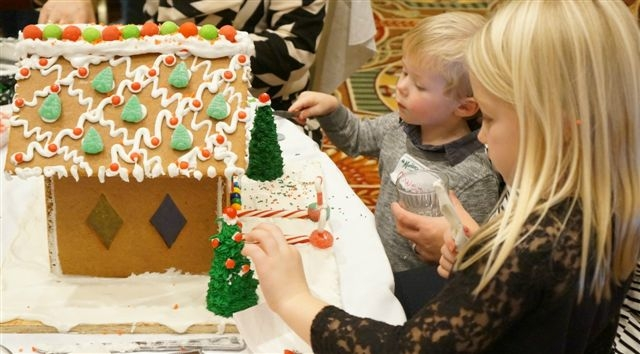 Kids decorating the gingerbread house at the Gingerbread House Luncheon