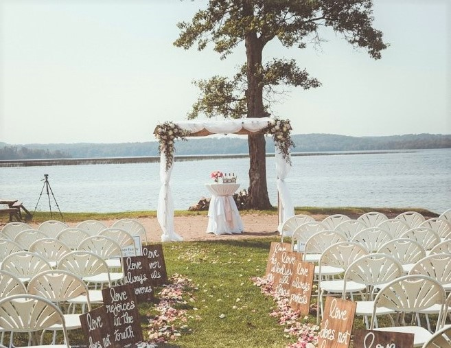 The aisle and wedding chair setup at Wilson Bay Beach ceremony