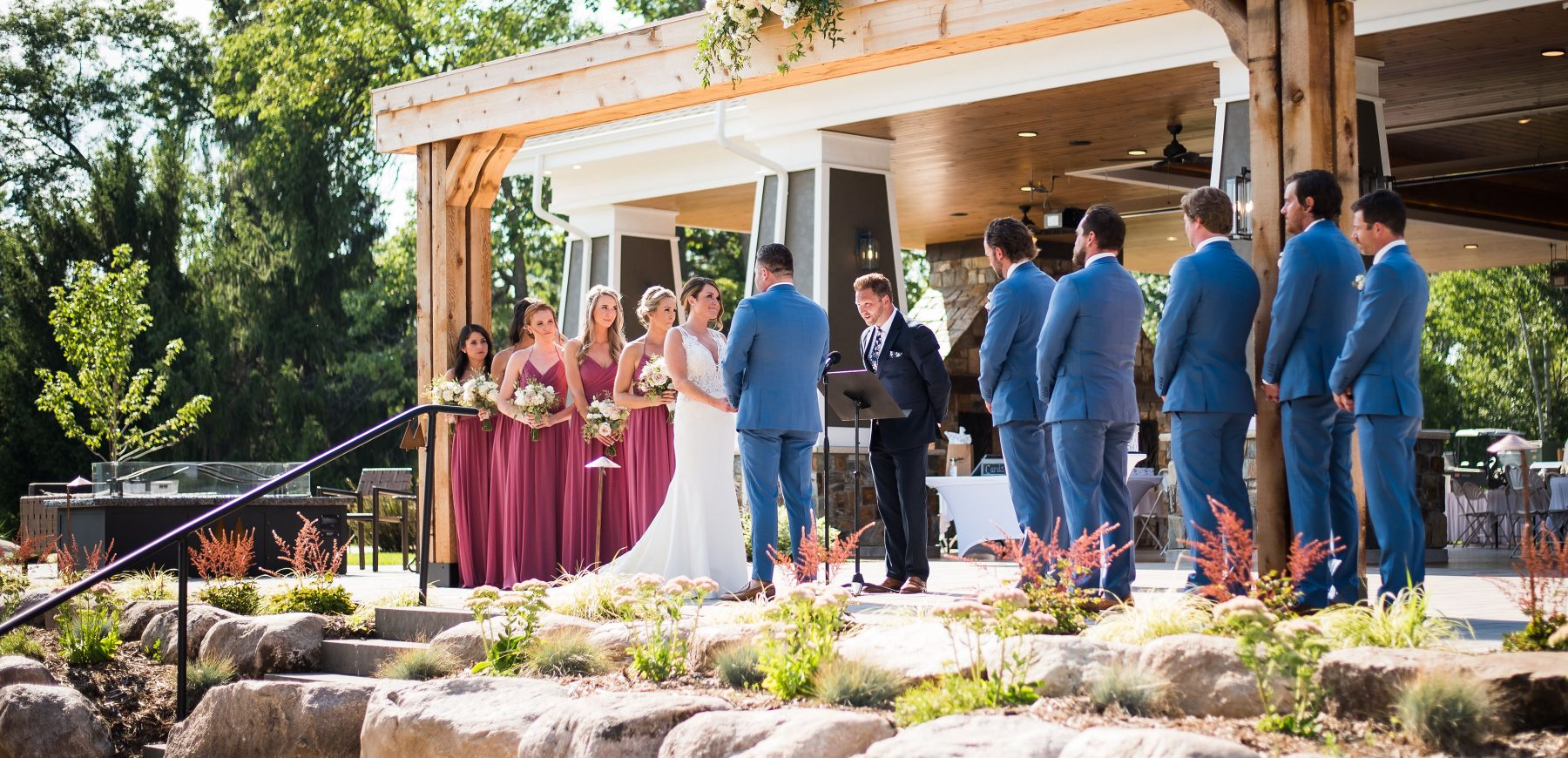 Bride and groom with their groomsmen and bridesmaids on the aisle at The Pavilion