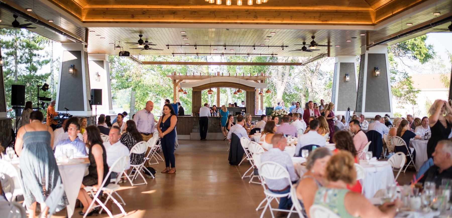 Wedding guests seated at the dining tables in the Pavilion