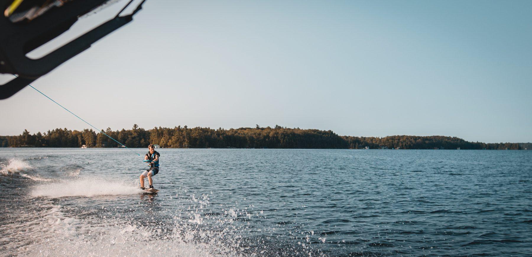 A man wake boaring on the Gull Lake at Maddens.