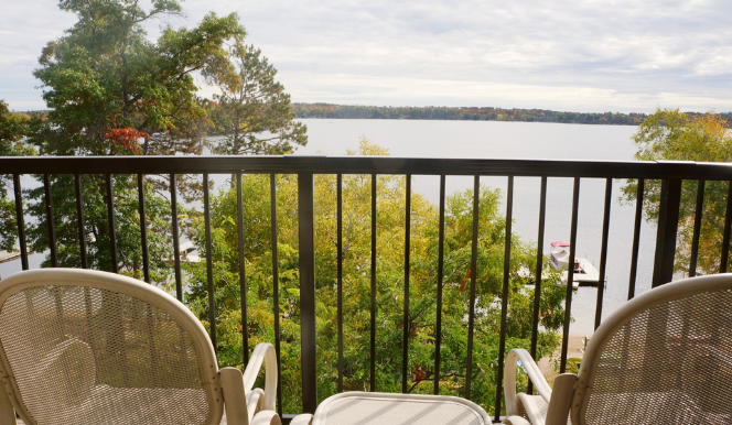 two chairs on balcony face steamboat bay lake