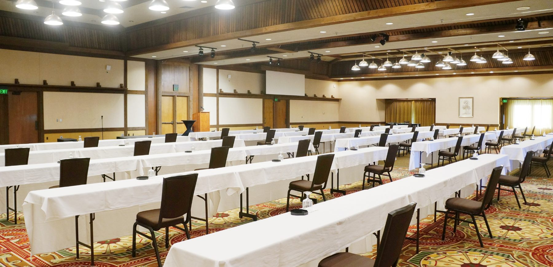 governors ballroom set up with long tables and chairs placed at a social distance