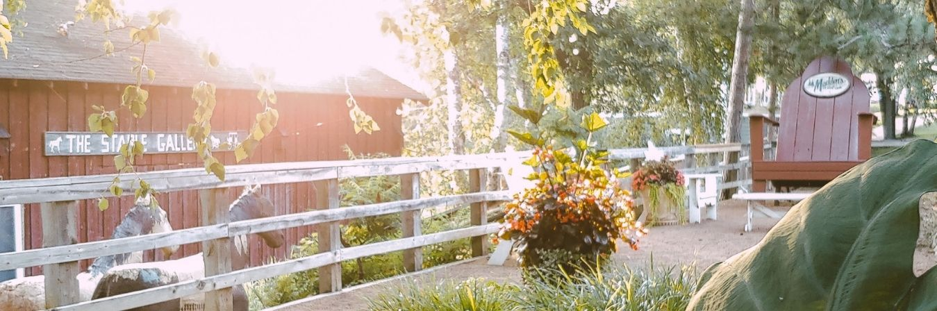 wooden fence in front of barn