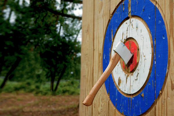 axe stuck in bullseye of wooden target