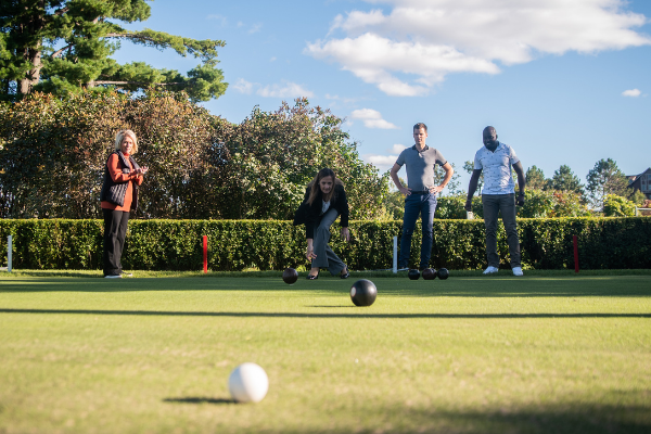 group of people lawn bowling