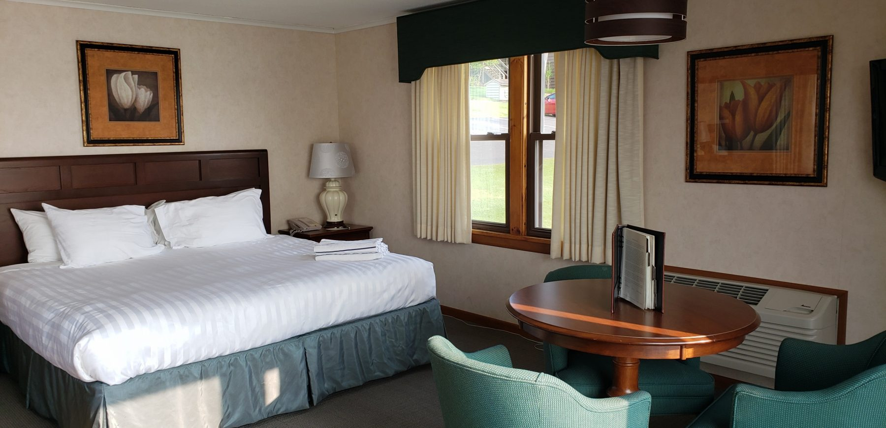 hotel bedroom with seating area