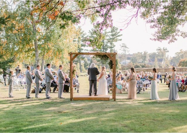 wedding ceremony outside under trees