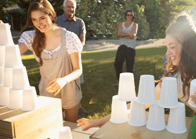 girls compete to stack cups