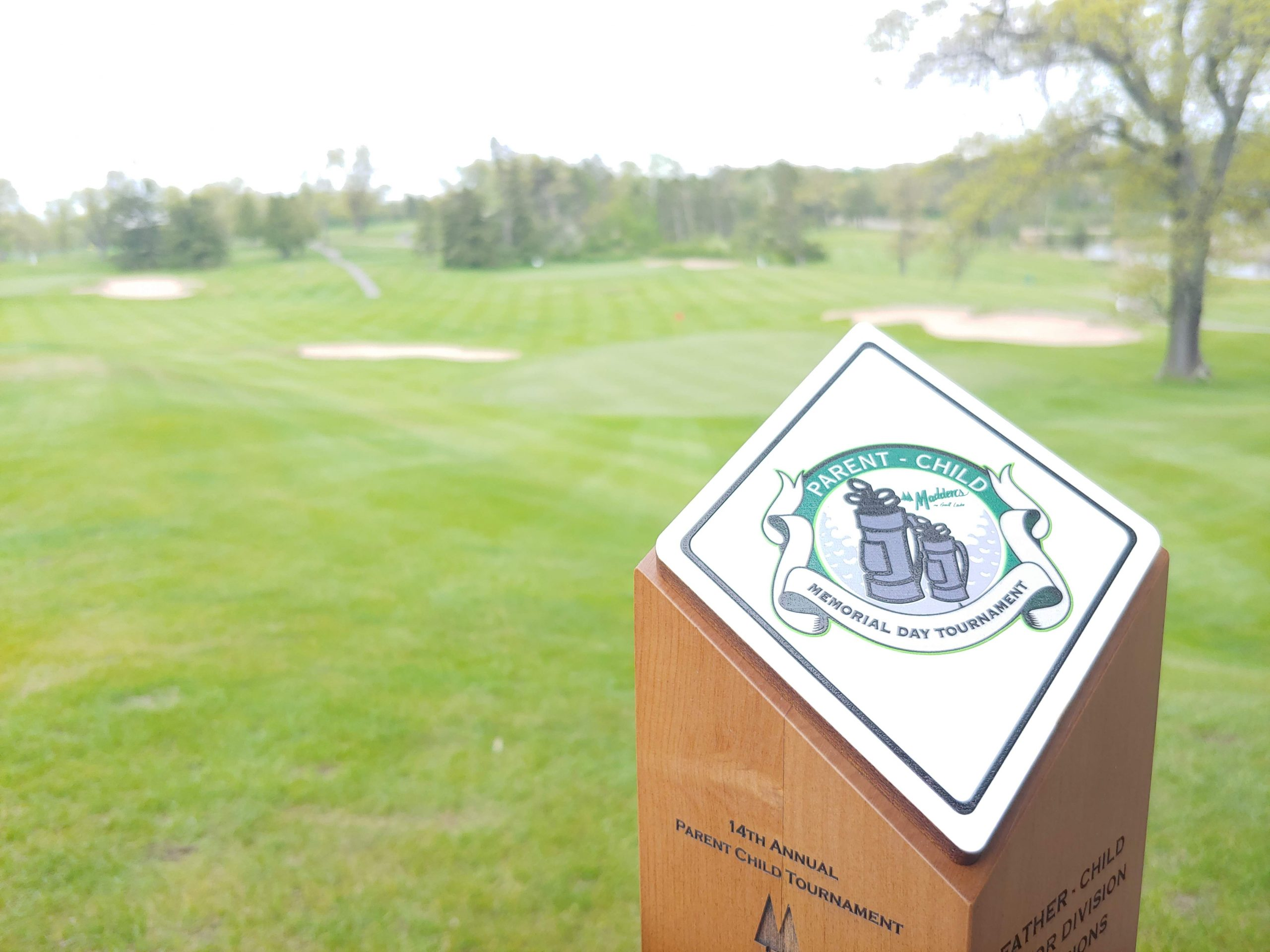 parent child memorial day tournament award on golf course