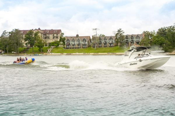 speedboat pulls people on inflatable boat