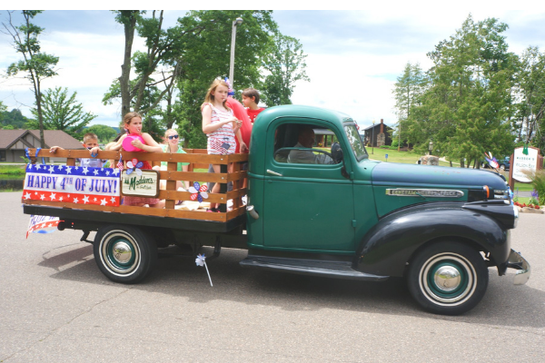 vintage pickup truck in a 4th of July parade