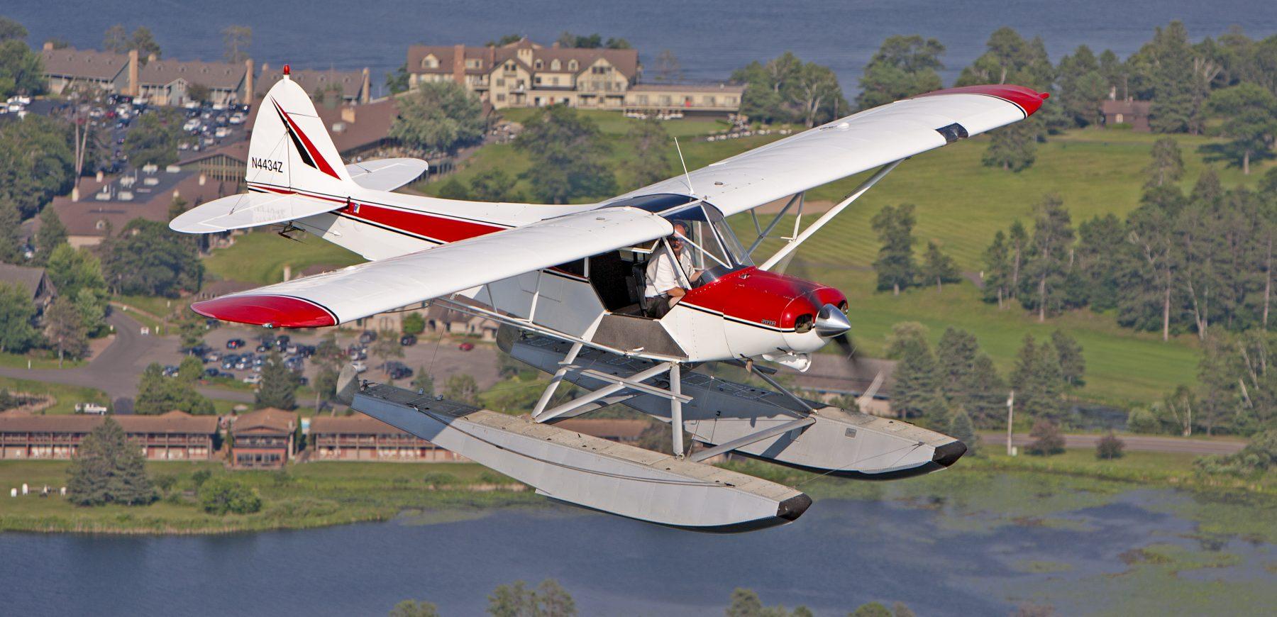 Super Cub Seaplane in Flight over Madden's on Gull Lake