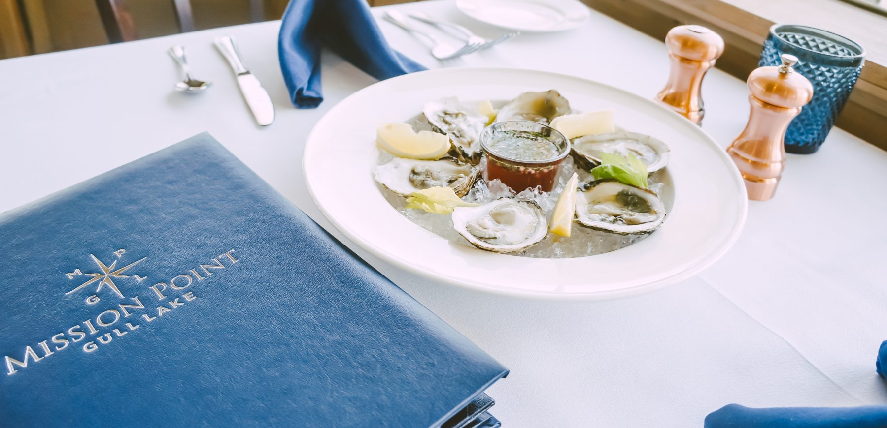 plate of oysters on a table at a restaurant