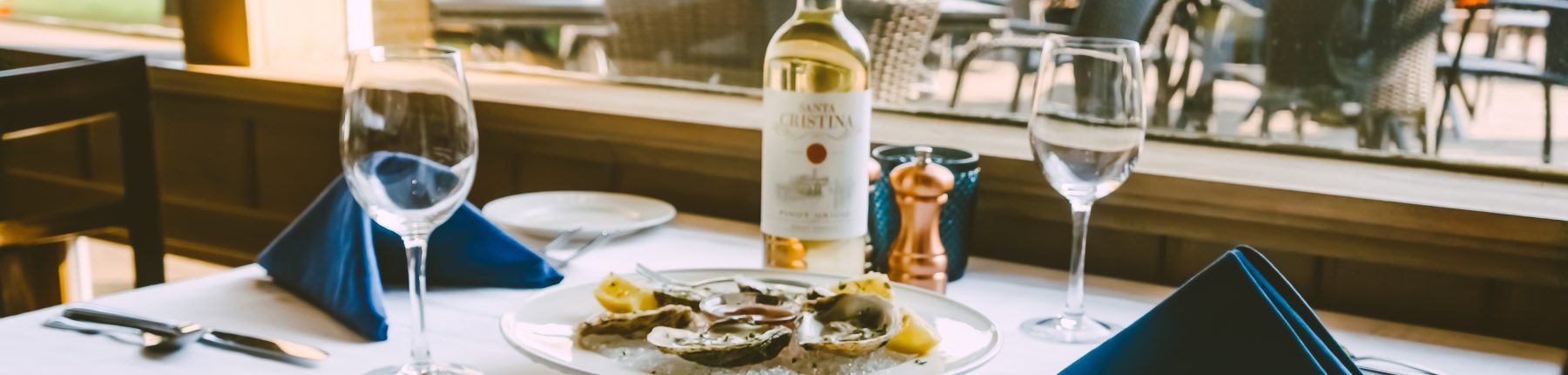 plate of oysters and a bottle of white wine