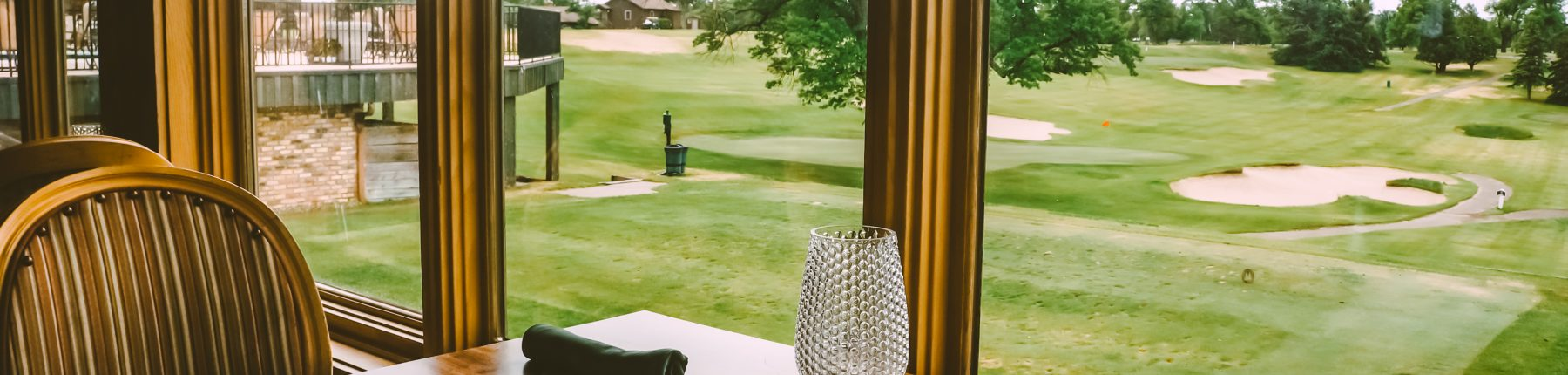 menu open on table overlooking golf course